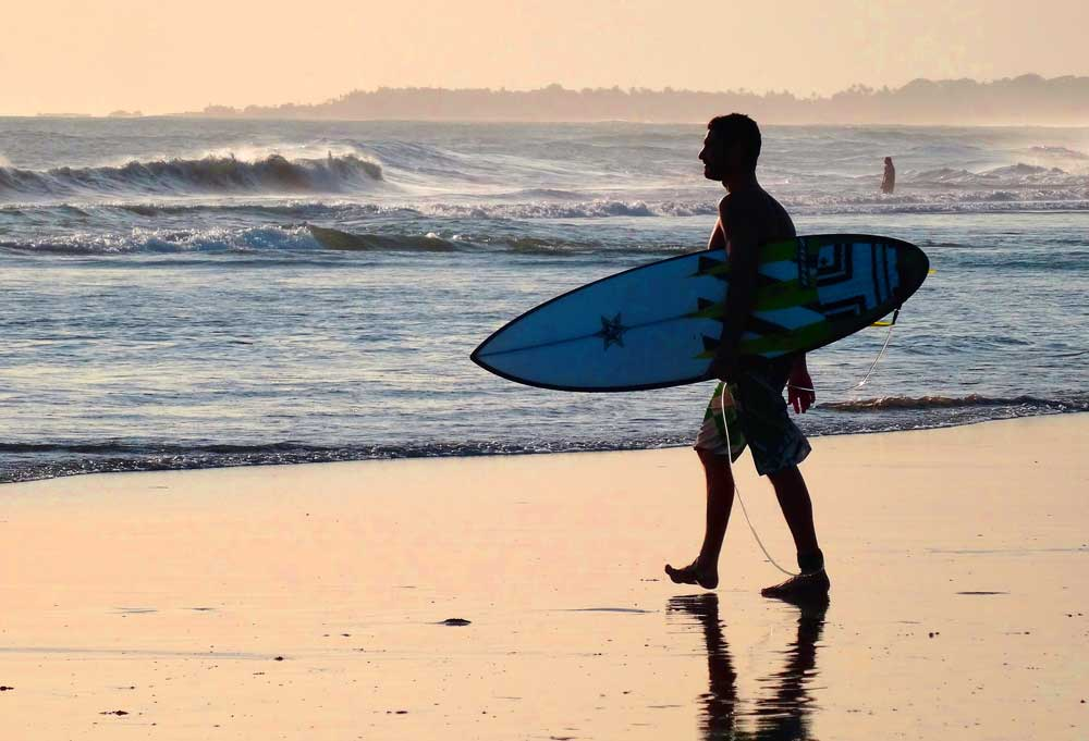 Surfer in Bali beach